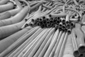 Flexible metal hose in a warehouse.Monohrome. — Stock Photo