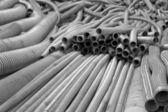 Flexible metal hose in a warehouse.Monohrome. — Stock Photo