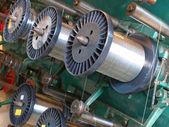Steel wire spools.Braiding machine. — Stock Photo