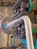 Flexible metal hose production line.Braiding machine. — Stock Photo