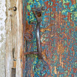 Stock Photo: Old wooden door and metal handle.