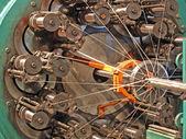 Flexible metal hose braiding machine taken closeup. — Stock Photo