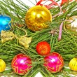 Multicolored Christmas balls and pine branch. — Stock Photo