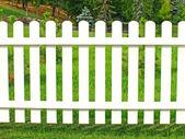 White fence in garden. — Stock Photo