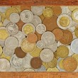 Old wooden frame with numismatic coins collection inside.Backgro — Stock Photo