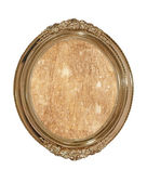 Golden oval photo frame with old brown canvas inside.Isolated. — Stock Photo