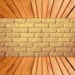 Yellow brick wall and wooden plank floor perspective. — Lizenzfreies Foto