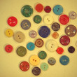 Set of retro buttons on yellow fabric suitable as background. — Stock Photo
