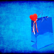 Blue Valentines Day gift bag and red heart on blue grungy backgr — Stock Photo