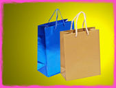 Blue and golden shopping bag with pink frame border. — Stock Photo