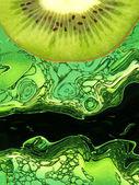 Kiwi slice taken closeup on green abstract background. — Stock Photo