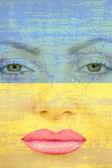 Pretty woman face with tear on Ukranian flag background. — Stock Photo