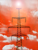 Electricity pylon with shine on red background. — Stock Photo