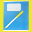 Blue writing book on a yellow background. — Stock Photo #51533075