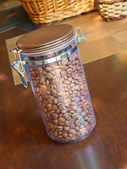 Coffee beans in glass container. — Stockfoto