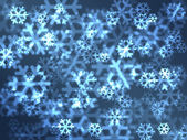 Ice blue festive snowflakes background. — Stock Photo