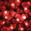 Stock Photo: Red hearts lens background.