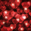 Red hearts lens background. — Stock Photo
