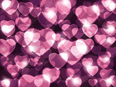 Parma pink hearts lens background. — Stock Photo