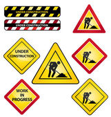 Under construction or work in progress road signs. Icons set. — Stock Vector