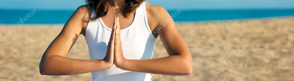 Woman Practicing Yoga Meditation near the Sea. Panoramic Photo with Copyspace.  Stock Photo #12505857