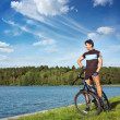 Man Riding a Bike on Beautiful Nature Background - Stockfoto