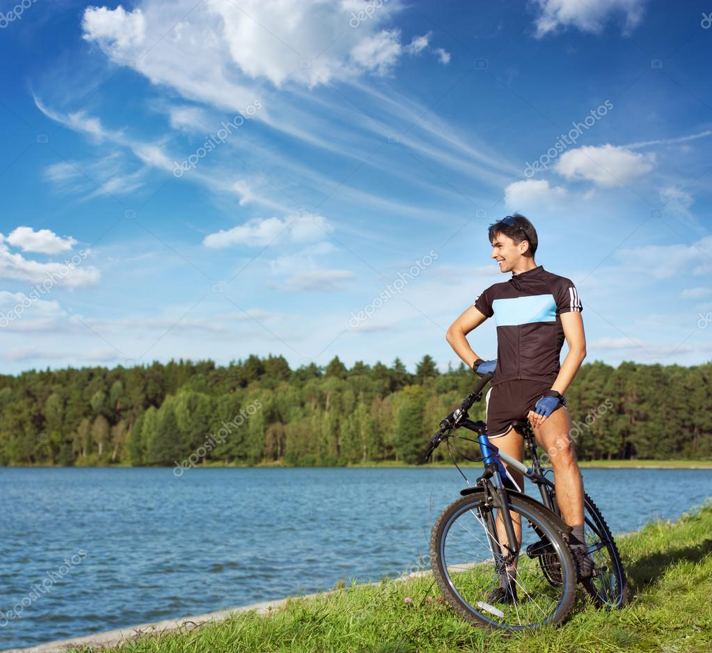Young Man On Bicycle. Healthy Lifestyle Concept. Copyspace.  Stock Photo #12888725