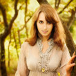 Portrait of Woman on Autumn Background - Foto Stock