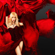 Sexy Woman with Splashing Red Silk — Stockfoto