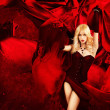 Sexy Blonde Fantasy Womwith Splashing Red Silk — Foto de stock #15627743