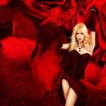 Sexy Blonde Fantasy Woman with Splashing Red Silk — Stock Photo