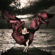 Blonde Woman with Waving Silk at Stormy Sea — Stockfoto