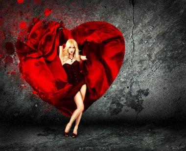 Woman with Splashing Heart on Dark Background