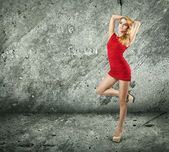 Beautiful Woman in Red Dress on Wall Background — Стоковое фото