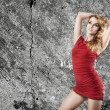 Beautiful Woman in Red Dress on Wall Background — Stok fotoğraf