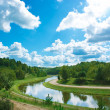 Summer Landscape with River and Clouds - Stock Photo