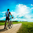 Foto Stock: Mwith Bike on Beautiful Nature Background