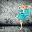 Woman in Splashing Turquoise Dress — ストック写真