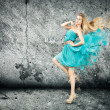 Stock Photo: Womin Splashing Turquoise Dress