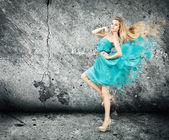 Woman in Splashing Turquoise Dress — Stock Photo