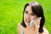 Happy Woman Talking on the Smart Phone — Stock Photo