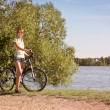 Woman with a Bike on Beautiful Nature Background — Stok fotoğraf