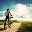 Man with a Bike on Beautiful Nature Background — Stock Photo