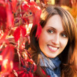 Portrait of Woman on Red Autumn Background — Photo