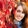 Portrait of Woman on Red Autumn Background — Stockfoto