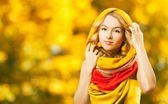 Blonde Woman in Yellow Hood on Autumn Background — Stock Photo