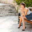 Portrait of Young Woman Sitting on the Bench — Stockfoto