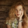 Portrait of Blonde Woman at the Wooden Wall — Stockfoto