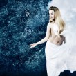 Blonde Woman in Cloud Dress at Grunge Blue Wall — Stok fotoğraf