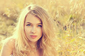 Portrait of Blonde Woman on Nature Background — Stock Photo